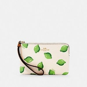 NWT Coach adorable lime print wristlet! PRICE FIRM